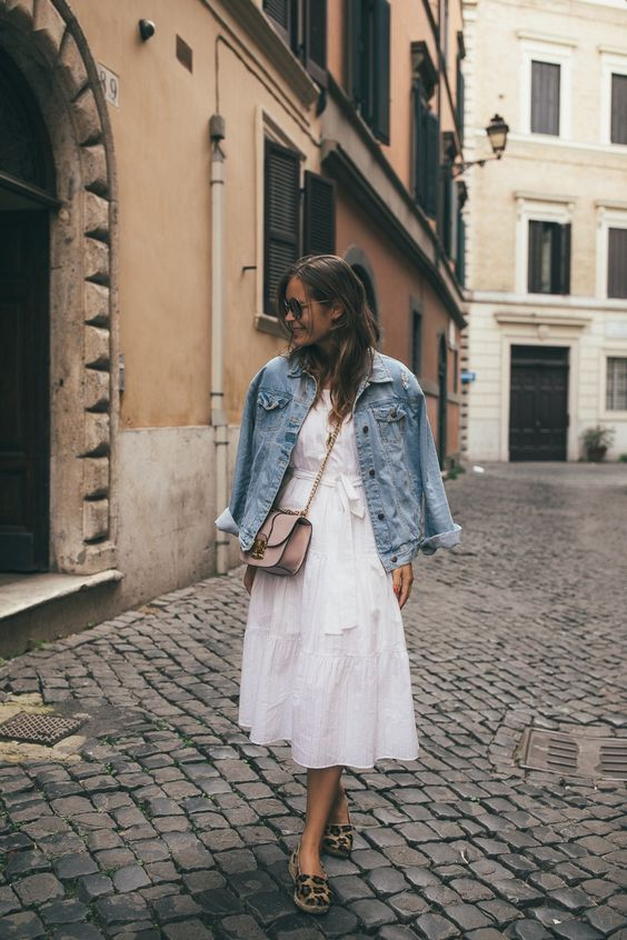 a romantic white midi dress, animal print slipons, a blush bag and an oversized denim jacket