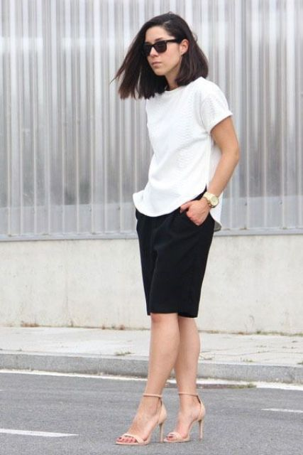 a white tee, black long shorts and nude heels for an office-appropriate look