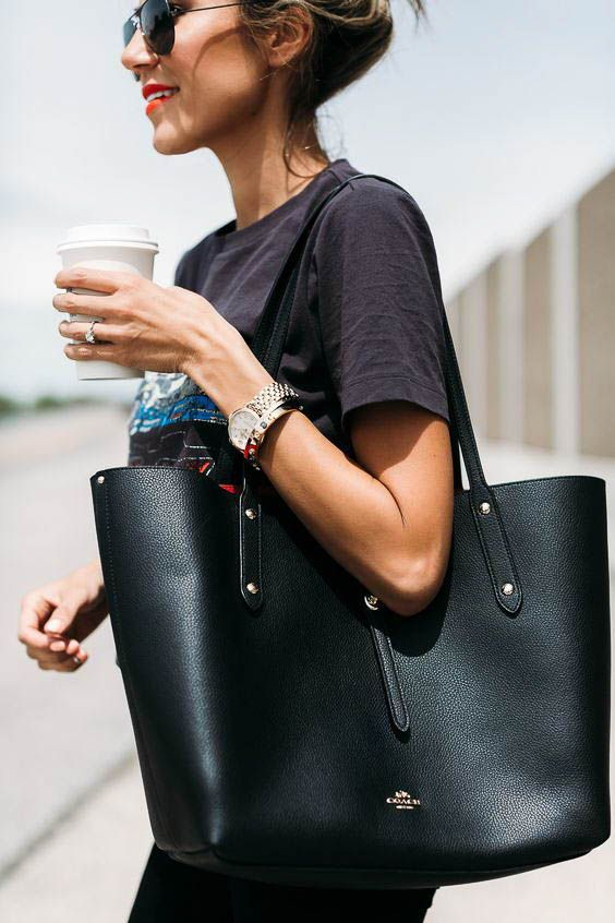 an oversized black leather tote is a timeless solution for modern work looks and for other outfits, too