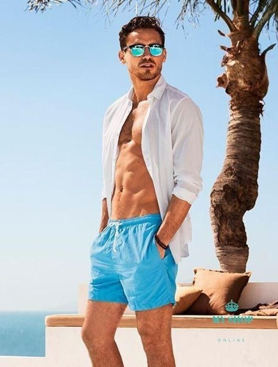 bright blue swim trunks paired with a white shirt is a timeless seaside combo