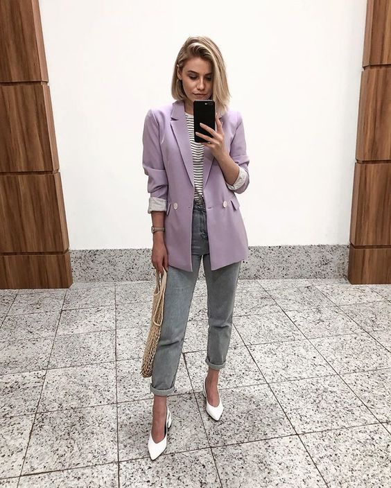 grey rolled up jeans, white shoes, a striped tee, an oversized lavender blazer and a crochet bag