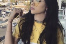 05 yellow sunglasses with an irregular shape and thin framing for a fashion statement