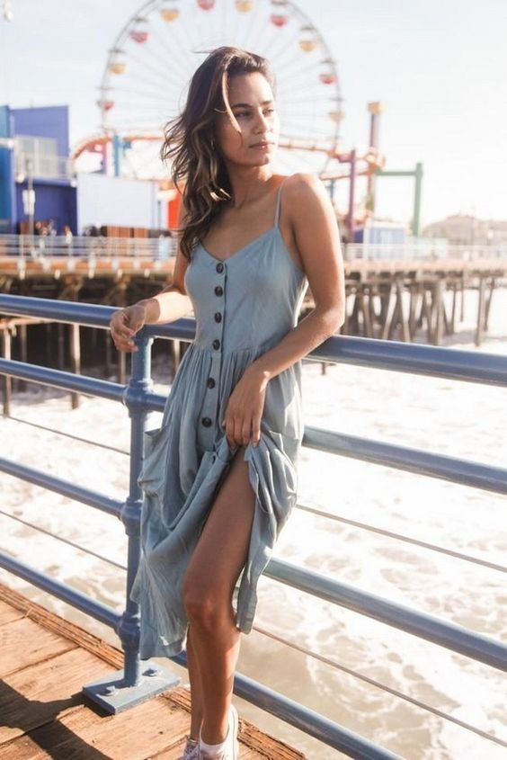 a comfortable light blue midi dress with a row of buttons and spaghetti straps plus white sneakers