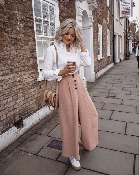 a creative work outfit with blush high waisted culottes, a white shirt, white sneakers and a brown leather bag