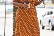 06 a mustard polka dot midi dress worn over a white t-shirt and white sneakers for a super comfy and cute outfit