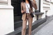06 a stylish brown plaid suit, a white tee and white sneakers for a casual yet formal look