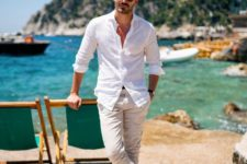 06 a stylish summer look with a white shirt, neutral pants, brown slippers always works