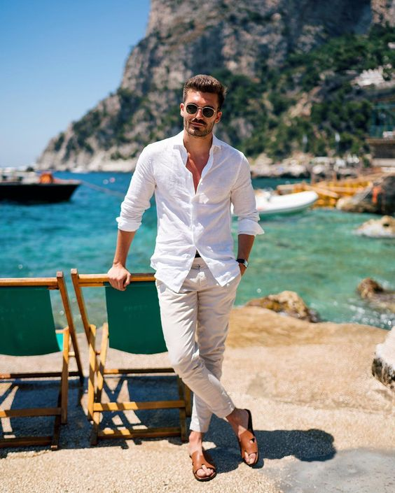 a stylish summer look with a white shirt, neutral pants, brown slippers always works
