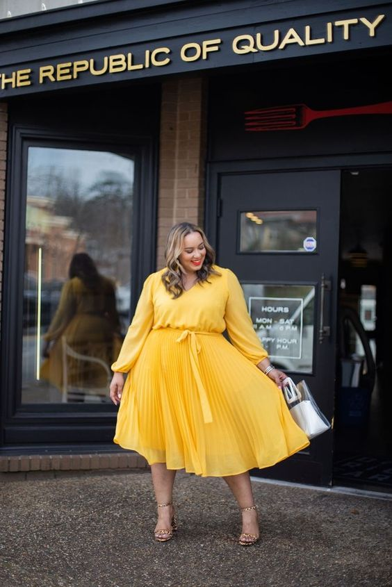 a sunny yellow midi dress with a pleated skirt, nude shoes and an acrylic bag