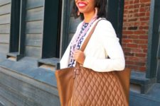 06 an oversized brown leather tote with a pattern is a comfortable everyday solution