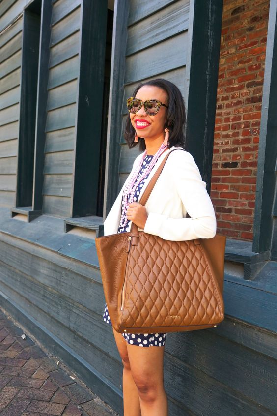 an oversized brown leather tote with a pattern is a comfortable everyday solution