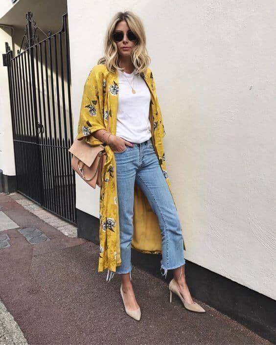 blue raw hem cropped jeans, a white tee, a mustard floral kimono, nude heels and a blush bag