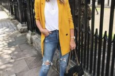 06 blue ripped jeans, a basic white tee, black shoes and a black bag plus a sunny yellow oversized blazer