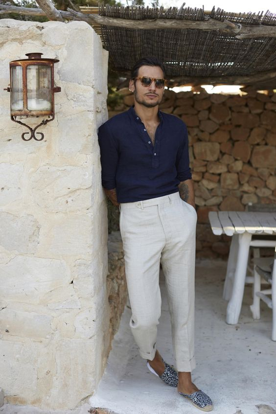 a chic outfit with a navy shirt, neutral pants and printed espadriles for a marine inspired touch