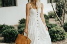 07 a comfortable white A-line midi dress on a row of buttons, brown strappy shoes, a straw hat and a brown bag
