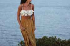 07 a mustard midi skirt on a row of buttons is a relaxed boho chic option for the beach