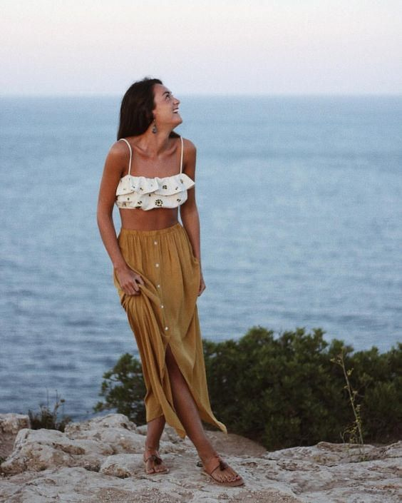 a mustard midi skirt on a row of buttons is a relaxed boho chic option for the beach