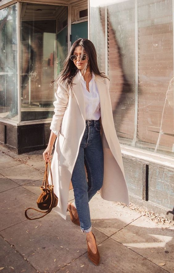 a white button down, blue high waisted jeans, brown shoes and a creamy coat for university casuals