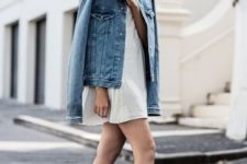 07 a white mini dress, white sneakers and an oversized denim jacket for a minimal look