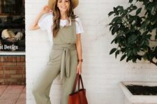 07 a white tee, a green overall, brown leather sandals and a matching tote bag plus a straw hat