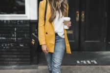 07 a white top, grey cropped jeans, two tone shoes, a yellow overiszed blazer and a black bag