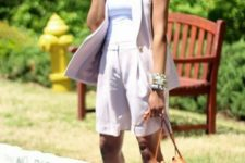 07 light pink shorts and a long waistcoat, a white top, florla heels and a camel bag