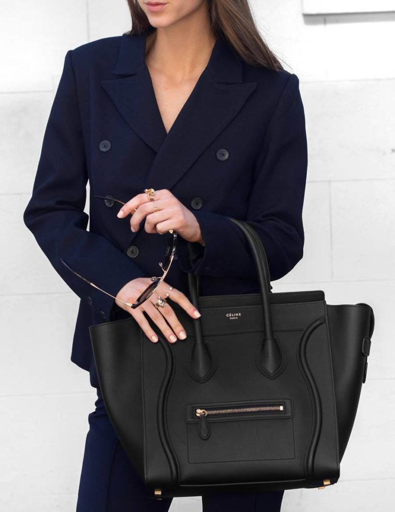 a large black tote by Celine is a great invest and it will easily accommodate your laptop, too