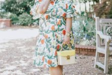 08 a retro print wrap midi dress with short cutout sleeves and a neutral bag will prevent you from overheating