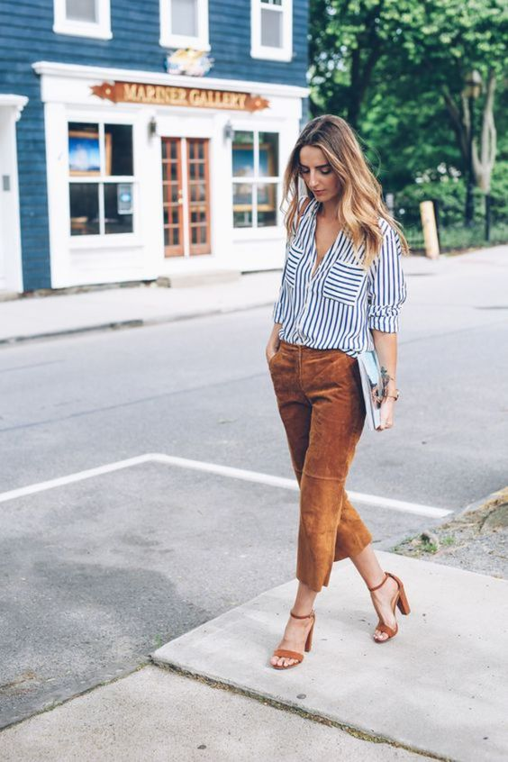 a striped black and white shirt, rust colored cropped pants and matching shoes plus a clutch