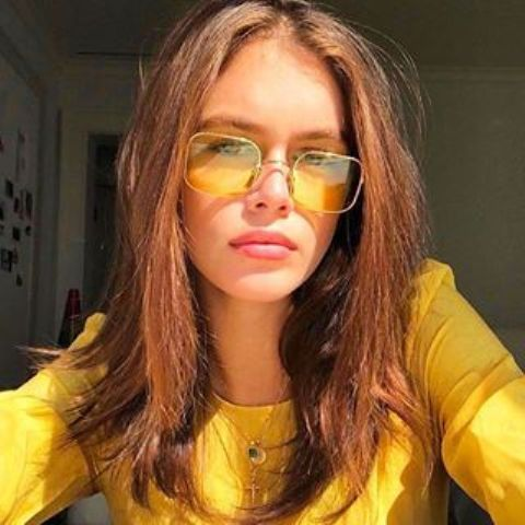 bright yellow sunglasses with thin gold frames are a very sunny and cool accessory