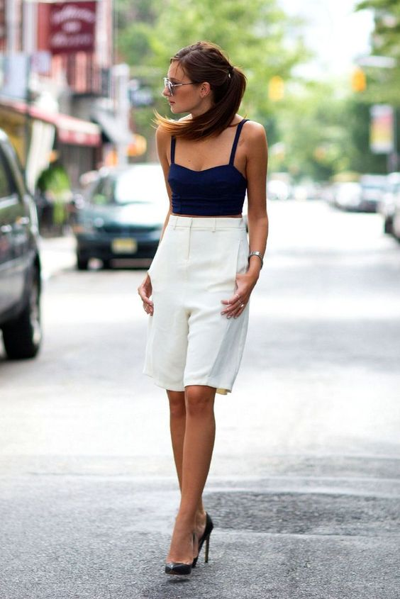 long white bermuda shorts, a navu crop top, black heels for a formal yet very sexy look - add a blazer and go to work