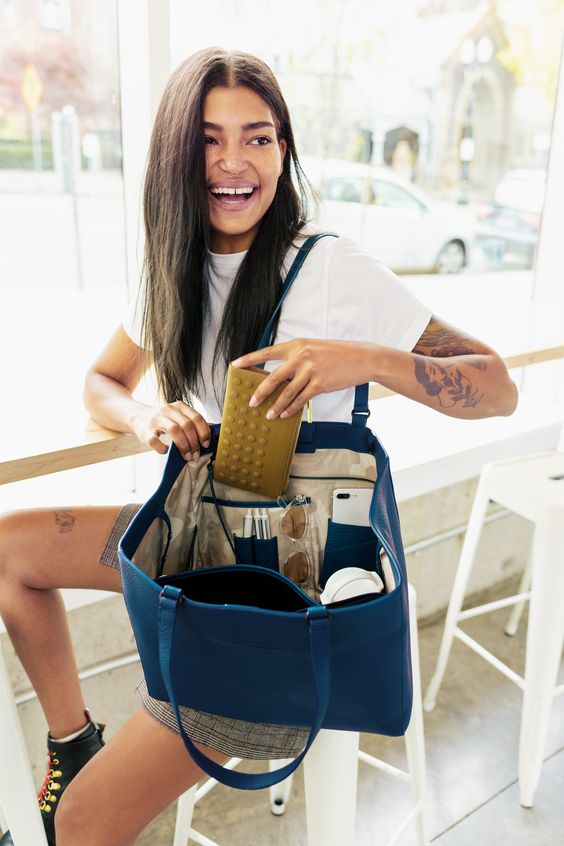 such a tote in bold blue is a great color accent for your work outfit and will accommodate everything
