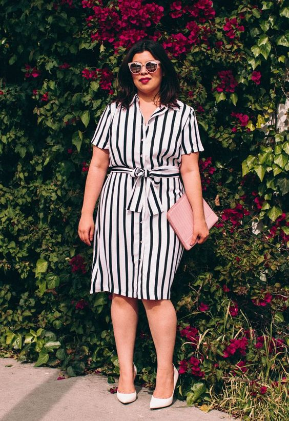 a black and white knee dress with white shoes and a pink clutch is a hot idea for summer
