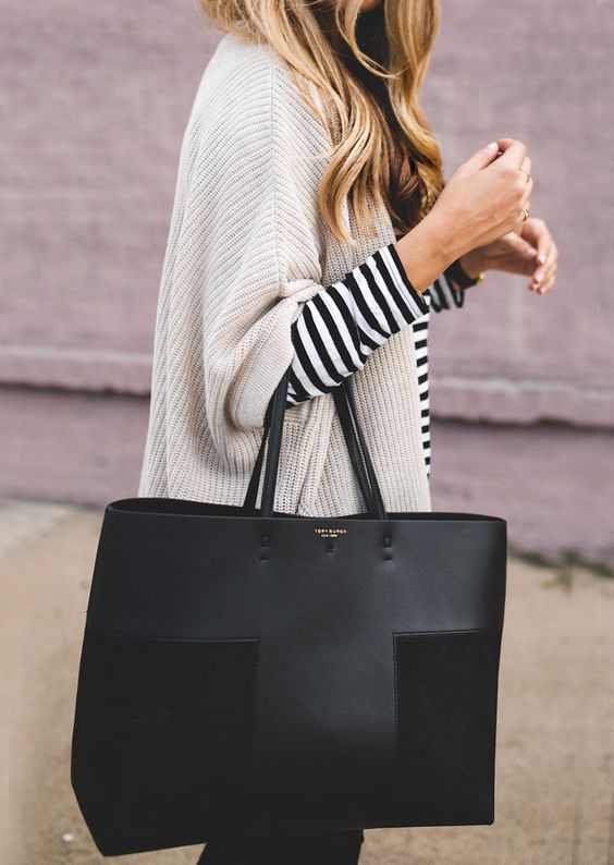 a large designer tote of black leather and suede is a stylish and minimalist accessory to go to work and not only