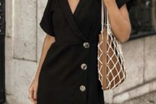 09 a minimalist black mini dress with a deep neckline, short sleeves and buttons, layered necklaces and a trendy bag