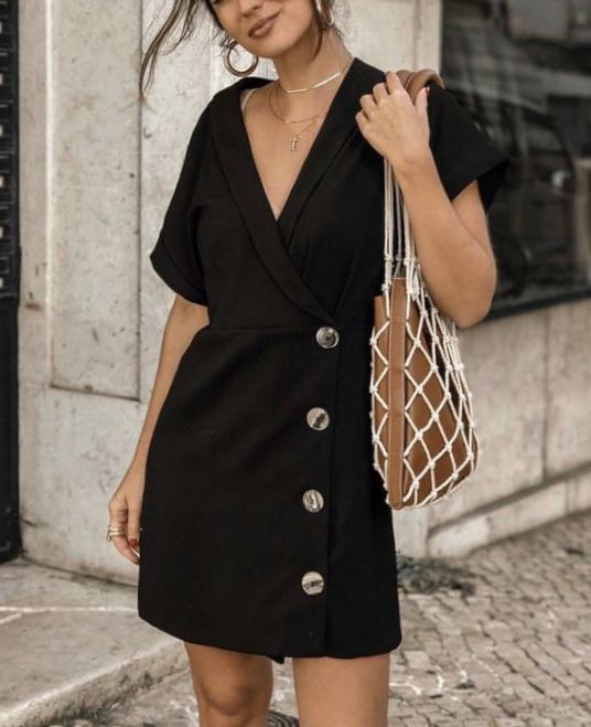 a minimalist black mini dress with a deep neckline, short sleeves and buttons, layered necklaces and a trendy bag
