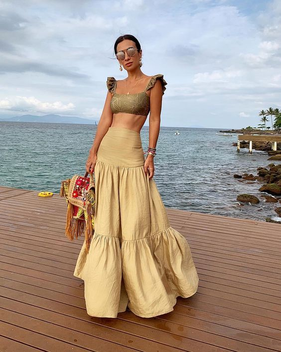 a statement yellow maxi skirt with a slight ruffle is a gorgeous idea to create a feminine and gypsy look
