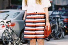 09 a white oversized button up, striped long shorts, a red bag and bright shoes to create a summer office look
