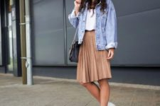 09 a white tee, a beige pleated knee skirt, white sneakers and a blue oversized denim jacket