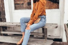 09 blue ripped jeans, nude heeled sandals and a marigold top with puff sleeves