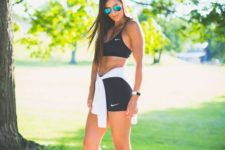 10 a black sporty set of a bra, shorts and white trainers for a minimalist workout look
