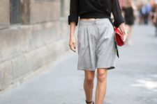 10 a black wrap shirt, grey shorts, black strappy shoes and a small red clutch for a statement