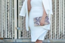 10 a chic white fitting knee dress, a matching oversized blazer, metallic shoes and a snake print clutch