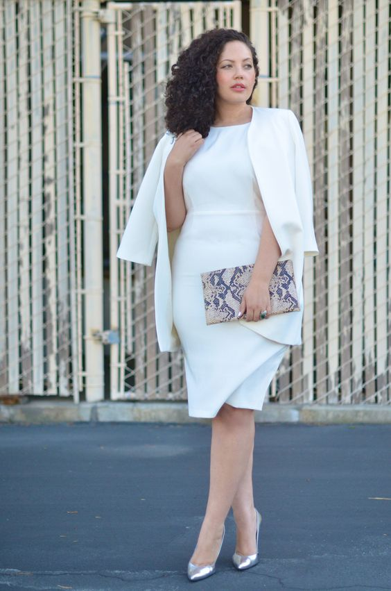 a chic white fitting knee dress, a matching oversized blazer, metallic shoes and a snake print clutch