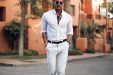 10 a dashing outfit with neutral pants and a white shirt, black loafers and a neck tie