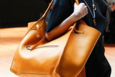 10 a stylish amber leather catch all bag can be used for travelling, to go to work and everywhere else you want