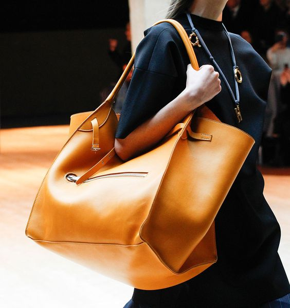 a stylish amber leather catch all bag can be used for travelling, to go to work and everywhere else you want