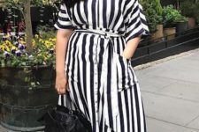 10 a stylish black and white striped midi dress with pockers and a row of buttons, nude heels and a black bag to wear to work