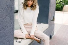 10 blush cropped pants, a white top with long sleeves and leopard print shoes, which are a hit