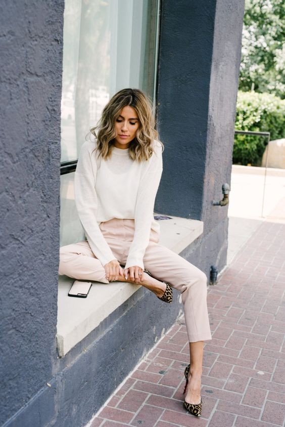 blush cropped pants, a white top with long sleeves and leopard print shoes, which are a hit